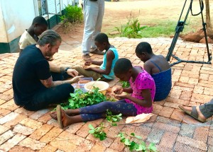 Lars Williams, Noma head of R&D, foraging Masokosiyana berries with some of Chido Govera's girls